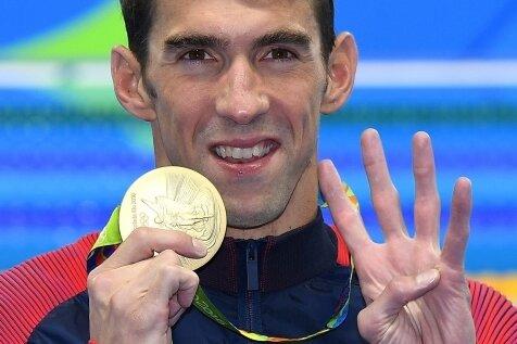 Stolzer Sieger: Michael Phelps gewann in Rio bisher vier Goldmedaillen.